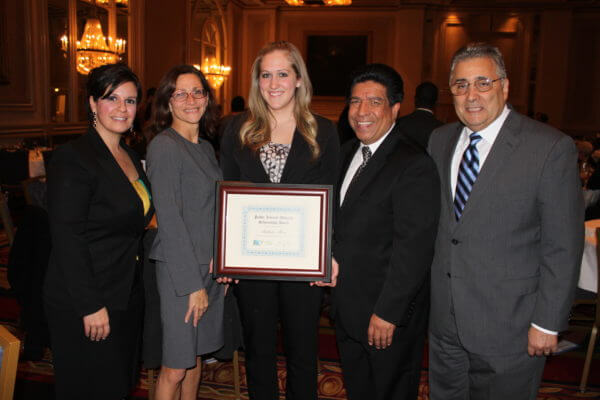 Pictured from left: Barbara N. Flores, DSF Scholarship Committee; Dean Jennifer Rosato Perea; second-year law student Rikkilee Moser; Hon. Jesse G. Reyes, DSF President; and Hon. William Haddad (ret.).