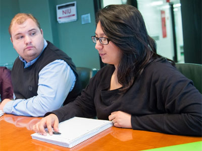 Lizy Garcia brainstorms with classmates at the Center for NGO Leadership and Development.