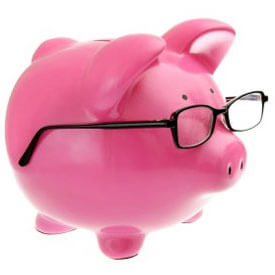 Photo of a piggy bank with glasses