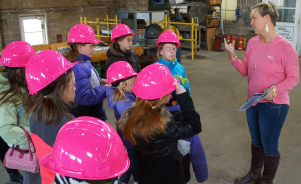 "Students from NIU STEM Saturdays STEM Divas most recent class recently had an opportunity to get a behind the scenes look at the ""real-world"" application of STEM principles on a tour of WALT LTD headquarters with company CFO Louisa McCarthy. Walt recently signed on as a program sponsor, providing hot pink safety gear for class participants."