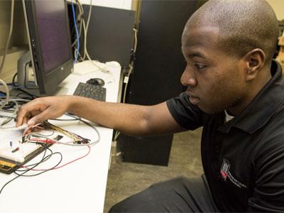Anthony Roberts applies his experimental skills in NIU's Biomedical Engineering & Sensor Laboratory.