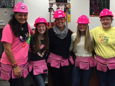New bright pink safety gear is now waiting for the next class of STEM Divas. From left: NIU STEM Outreach Associate Pettee Guerrero; Carolyn McCarthy; Walt, LTD CFO Louisa McCarthy; Madelyn McCarthy; and STEM Outreach Director Pati Sievert.