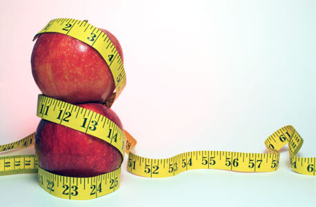 Photo of apples in measuring tape