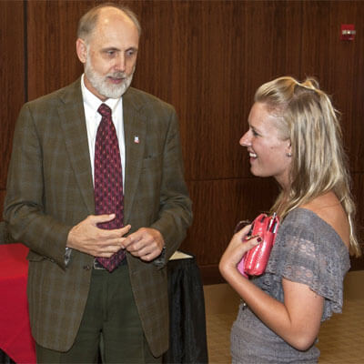 President Baker chats with a student Sept. 5, 2014, after the signing of a reverse-transfer agreement with the College of Lake County.
