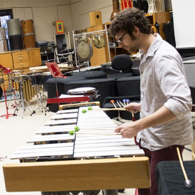 An NIU percussion student plays the xylophone.