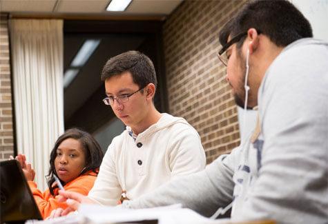 NIU student in Founders Memorial Library