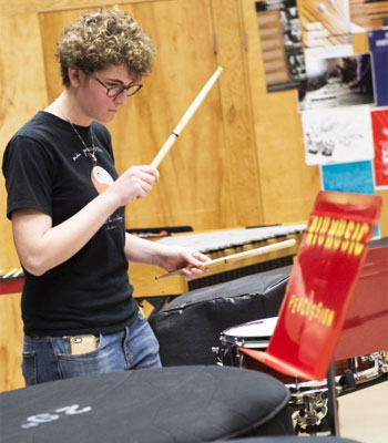 An NIU student plays the snare drum.