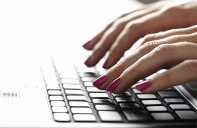 Photo of fingers typing