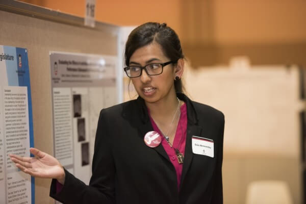Erin Hernandez explains her research at the 2015 Undergraduate Research and Artistry Day.