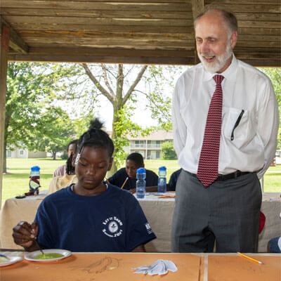 NIU President Doug Baker visits Camp Power in July 2014.