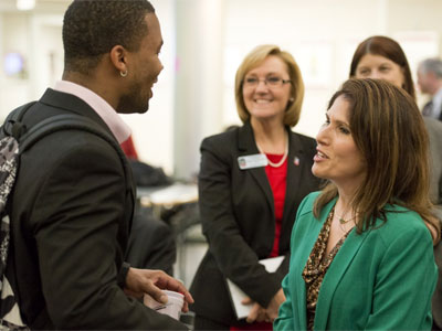 Lt. Gov. Evelyn Sanguinetti visits with an NIU student.
