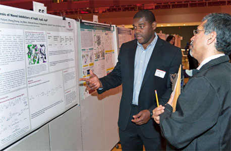 "Sophomore chemistry major Sterling Pollard presents his ""Fragment Based Drug Discovery Analog Activity with respect to the MEP Pathway"" project during the 2014 URAD."