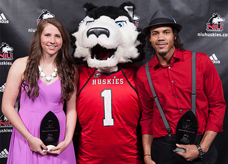 Student-athletes pose with Victor E. Huskie