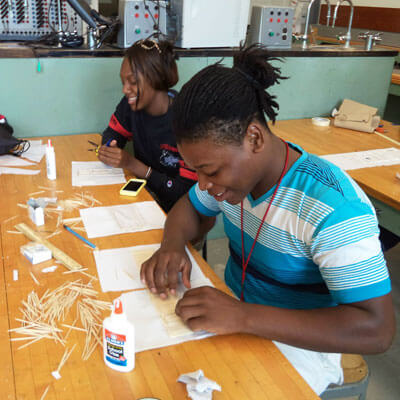 STEM Career Exploration campers explore engineering concepts through hands-on activities like bridge-building.