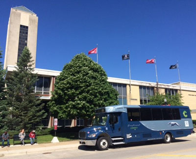 Greyhound bus at Holmes Student Center