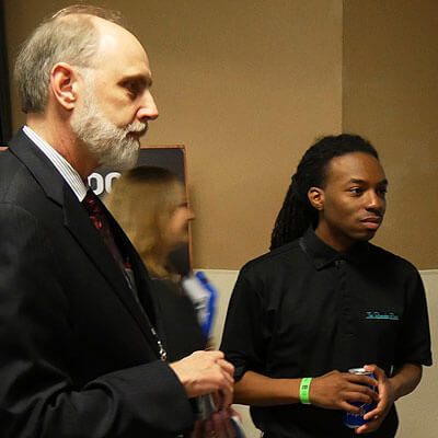 NIU President Doug Baker and Randiss Hopkins at We Day Illinois