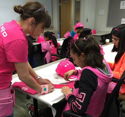 Female STEM experts, such as NIU graduate student Erin Spencer, will serve as mentors to participants throughout the day.