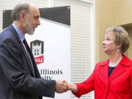 NIU President Doug Baker and McHenry County College President Vicky Smith celebrate a new transfer program.