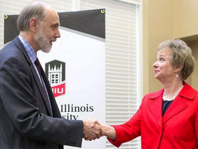 NIU President Doug Baker and McHenry County College President Vicky Smith celebrate a new transfer program.