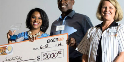 Tracie Burress, seen here with her husband, Glen, and EIGERlab's Sherry Pritz, was awarded $5,000 and named the winner of the 2014 FastPitch competition for sockTABs.