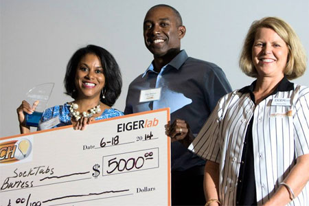 Tracie Burress, seen here with herhusband, Glen, and EIGERlab's Sherry Pritz, wasawarded $5,000 and named thewinner of the 2014 FastPitch competition for sockTABs.