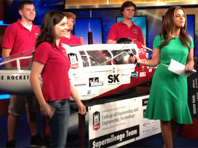 NIU Supermileage Team members Lindsey Dodis, Kevin Kuebrich, Christian McAdoo and Russell Fordyce on the set of WFLD-TV's Good Day Chicago with the Huskie Rocket.