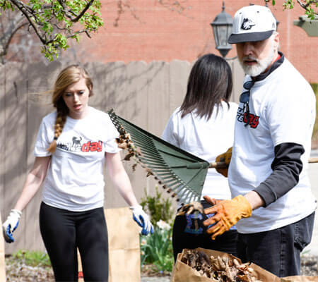 President Baker bags leaves during NIU Cares Day.