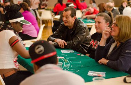 An NIU family enjoys Casino Night during the 2014 Fall Family Weekend.
