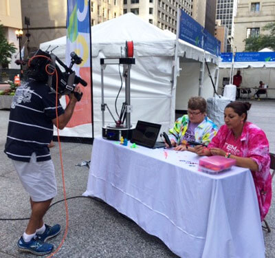 NIU's Pettee Guerrero (right) and Pati Sievert made the TV news during Wednesday's Google Geek Street Fair in Chicago.