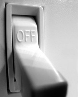 "Photo of a light switch in the ""off"" position"