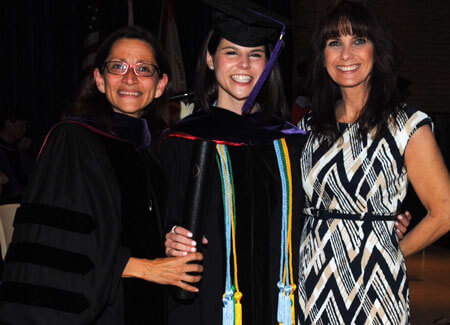 Former NIU Law Dean Jennifer Rosato Perea congratulates new grad Shaina Kalanges and Donna Sandacz, an NIU Law alumna and Shaina's mother.