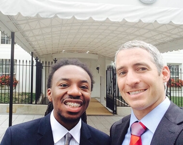 NIU student Randiss Hopkins and senior advisor to the Vice President and Special Assistant to the President Greg Schultz pose in front of an entrance to the White House on August 4.