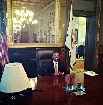 Randiss Hopkins takes a seat at the conference table in the Vice President's Ceremonial Office during his visit the White House on August 4.