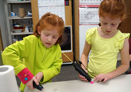 STEM Divas use 3Doodlers, a hand-held technology similar to that of 3D printers, to create their own jewelry.