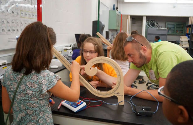 Sam Watt leads Engineering Amusement campers in constructing model roller coasters.