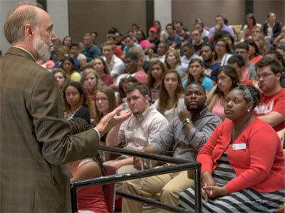 NIU President Doug Baker speaks Wednesday to residence hall community advisers.