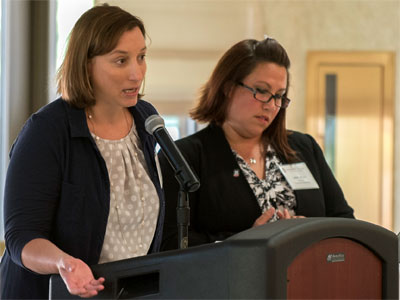 Jennice O'Brien (left) and Abby Dean explain marketing and web efforts during the Aug. 7 Strategic Plan Implementation Leadership Retreat.