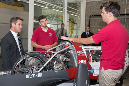U.S. Congressman Adam Kinzinger, R-Channahon, chats Thursday with members of NIU's Supermileage Team.