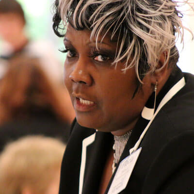 Flecia Thomas, dean of students at McHenry County College, reported on student support services.