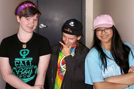 Participants from STEM Outreach's summer camps show off their wearable electronic projects.