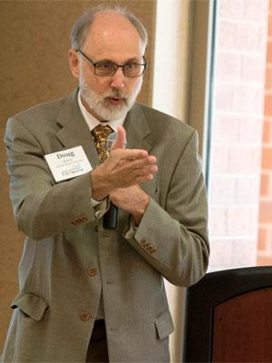 NIU President Doug Baker addresses members of the Northern Illinois Regional P-20 Network.