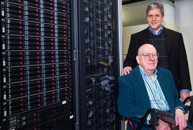 Clyde Kimball and Nicholas Karonis with NIU's computer cluster in 2012.