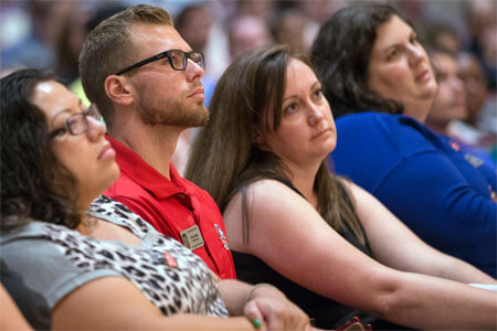 NIU staff members listen during the Sept. 2 town hall meeting.NIU staff members listen during the Sept. 2 town hall meeting.