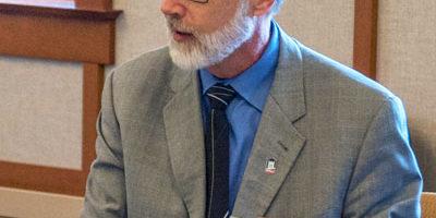 NIU President Doug Baker talks to members of the VAWA Implementation Committee.