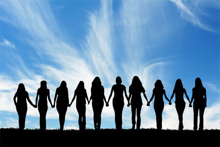 A photo of women in silhouette holding hands