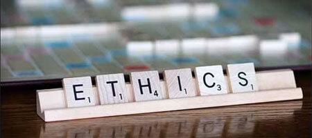 """Scrabble letter spelling the word """"ethics"""""""
