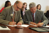 NIU President Doug Baker and SVCC President Scott Hellmich, sign agreements Tuesday that create new pathways to degrees for SVCC students.