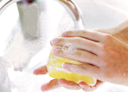 Photo of someone washing hands with soap