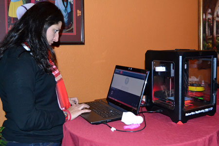 STEM Outreach Associate Pettee Guerrero demonstrates a MakerBot at a past presentation of The 3D Printing Revolution.