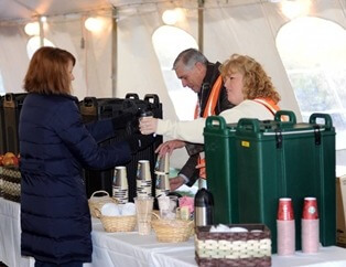 Volunteers handed out coffee, hot chocolate and other concessions to fans in the Spirit Zone tent during the inaugural year of IHSA Destination DeKalb in 2013.